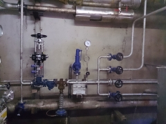Steam regulation and control circuit for alembic