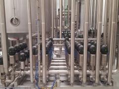 Manifold de válvulas en planta de envasado de zumos